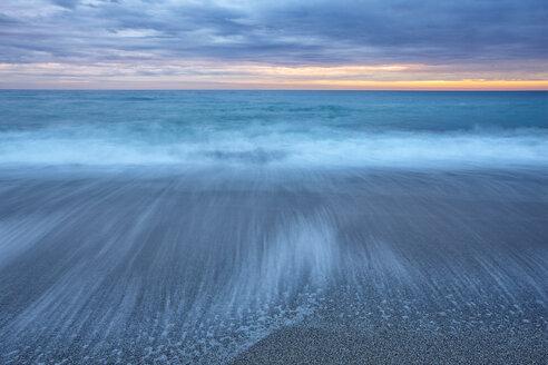 Spain, Andalusia, Natural Park of Cabo de Gata-Nijar, beach and ocean at dusk - DSGF000163