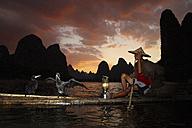 China, Guangxi, Xingping, cormorant fisherman on Li river - DSG000222