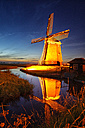 Netherlands, North Holland, windmill at sunset - DSGF000787