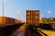 Germany, Hamburg, railway yard, freight train in the evening light - MS004288