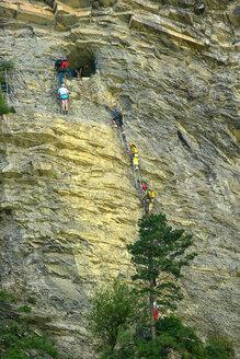 Spain, Ordesa National Park, people climbing at rock face - DSG000403