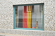 German flag and soccer ball in window - BSCF000442
