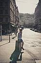 France, Department Rhone, Lyon, Historic town centre, Boy sitting on bollard - SBDF001293