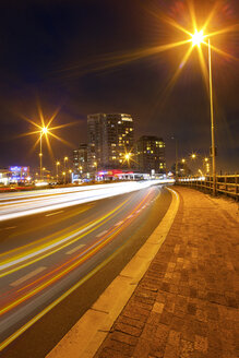 South Africa, Cape Town, light trails at busy street by night - ZEF001234