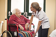Nurse caring for senior woman in wheelchair - ZEF001297