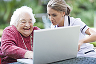 Nurse and senior woman using laptop together - ZEF001301