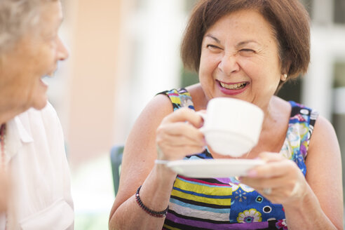 Two happy senior women drinking coffee together - ZEF001303