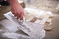 Close-up of construction worker with tiling trowel - ZEF001825