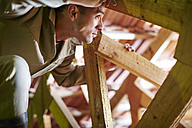 Construction worker working on roof beams - ZEF001844