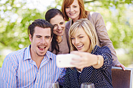 Happy friends taking selfie outdoors - ZEF001485