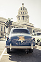 Cuba, Havana, blue vintage car parking in front of capitol - NN000035