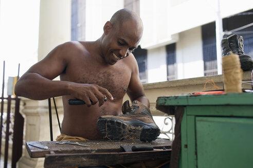 Cuba, Santiago de Cuba, cobbler at work - NN000077