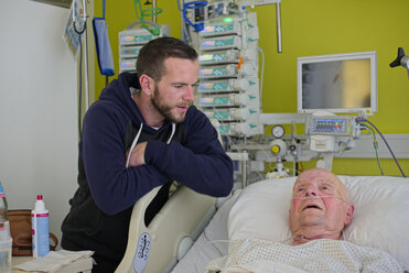 Grandson visiting his grandfather being in  intensive care after heart attack - LAF001087