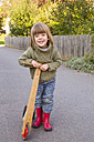 Smiling little girl with wooden scooter - LVF002013