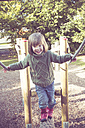 Little girl climbing on playground equipment - LVF002005