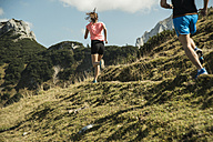 Austria, Tyrol, Tannheim Valley, young couple jogging in mountains - UUF002066