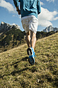 Austria, Tyrol, Tannheim Valley, young man jogging in mountains - UUF002088