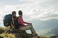 Austria, Tyrol, Tannheimer Tal, young couple resting on hiking tour - UUF002259