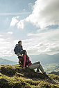 Austria, Tyrol, Tannheimer Tal, young couple resting on hiking tour - UUF002261
