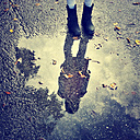 Girl reflecting in puddle - SARF000898