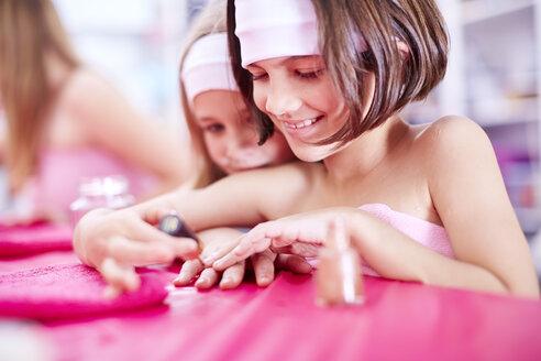 Girl on a beauty farm applying nail polish - ZEF001392