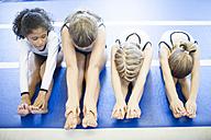 Four girls doing gymnastics exercise on floor - ZEF002003