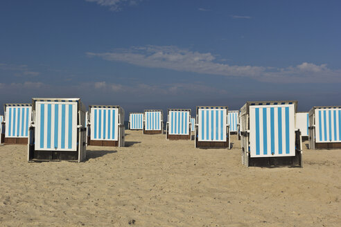 Germany, Mecklenburg-Western Pomerania, Warnemuende, beach chairs on a beach - MELF000021