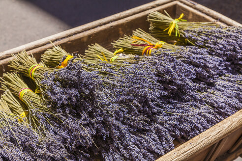 France, Provence, Aix-en-Provence, wooden box with bunches of lavender - WDF002703