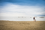 Mexico, man with toddler boy walking on the beach - ABAF001528