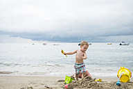 Mexico, toddler playing on the beach at seafront - ABA001534