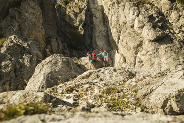 Austria, Tyrol, Tannheimer Tal, young couple hiking at rocks - UUF002152