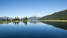Austria, Tyrol, Ehrwald, water reflections in Almsee - MKFF000138