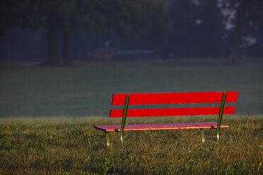 Germany, Red bench in autumn - JTF000582