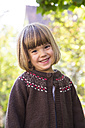 Portrait of smiling little girl wearing brown cardigan - LVF002056