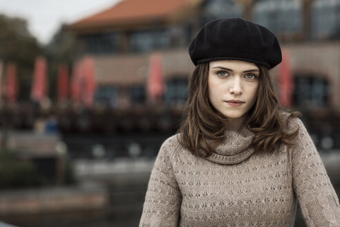 Portrait of serious looking young woman wearing beret and knitted dress - GDF000497