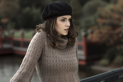 Portrait of young woman wearing beret and knitted dress - GDF000493