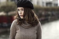 Portrait of young woman wearing beret and knitted dress - GDF000491
