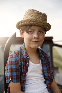 Portrait of smiling little boy wearing straw hat - FKIF000060