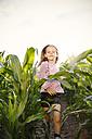 Little girl running through maize field - FKIF000073