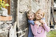 Portrait of two smiling little girls - FKIF000048