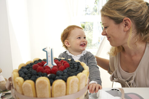 Mother and daughter celebrating little girl's first birthday with self-made fancy cake - FSF000228