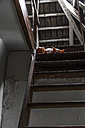 Doll lying on staircase to attic - JFEF000480