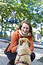 Portrait of smiling woman with her dog - JFEF000509
