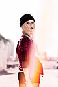 Stylish blond young woman wearing black wool cap - DAWF000167