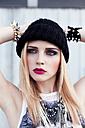 Portrait of stylish young woman wearing black wool cap - DAW000191