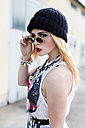 Stylish young woman wearing black wool cap and sunglasses - DAW000193