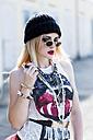 Portrait of stylish young woman wearing black wool cap and sunglasses - DAWF000194