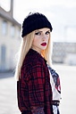 Portrait of stylish blond young woman wearing black wool cap - DAW000200