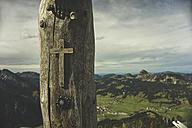 Austria, Tyrol, Tannheimer Tal, wayside cross at wooden pole - UUF002297