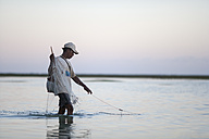 Indonesia, Bali, fisherman working in the sea - NNF000054